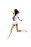 Young asian girl. Jumping up in the air Stock Photography