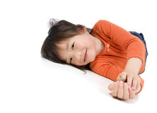 Young Asian Girl. A very cute asian girl laying on the floor being silly Royalty Free Stock Photo