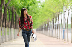 Young Asian girl in alameda. A beautiful Asian girl taking a walk in a pleasantly cool alameda Stock Photography