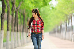 Young Asian girl in alameda Royalty Free Stock Photo