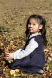 Young Asian girl and Autumn leaves Stock Photography