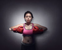 Young asian girl with boxing gloves. Over black background Royalty Free Stock Images