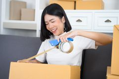 Young Asian girl casual moving in a new apartment, surrounded wi royalty free stock image