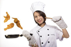 Young Asian girl cooking Fried chicken Royalty Free Stock Images