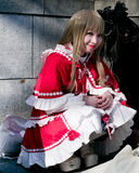 Young asian girl with cosplay looking. Young asian girl with red cosplay looking in Tokyo Royalty Free Stock Photo
