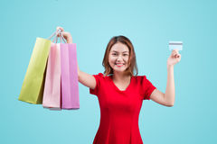 Young asian girl with credit card and shopping bags Stock Photo