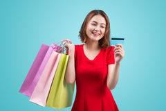 Young asian girl with credit card and shopping bags Stock Image