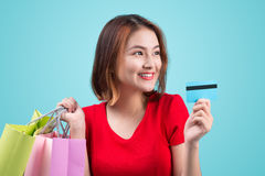 Young asian girl with credit card and shopping bags Royalty Free Stock Photo