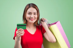 Young asian girl with credit card and shopping bags.  Stock Image