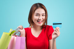 Young asian girl with credit card and shopping bags Stock Photography