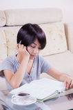 Young asian girl doing homework Stock Photos