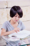 Young asian girl doing homework Royalty Free Stock Photography