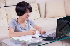 Young asian girl doing homework Royalty Free Stock Photos