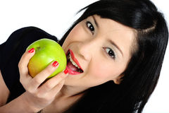 Young asian girl eating apple Stock Photo