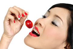 Young asian girl eating cherry Royalty Free Stock Image