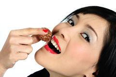 Young asian girl eating chocolate Royalty Free Stock Image