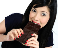 Young asian girl eating chocolate Stock Image