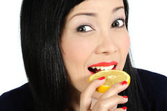 Young asian girl eating lemon Stock Image