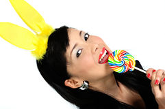 Young asian girl eating lollipop Stock Photos