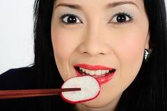 Young asian girl eating radish Stock Image