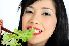 Young asian girl eating salad Stock Photos