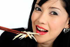 Young asian girl eating salad Royalty Free Stock Photography