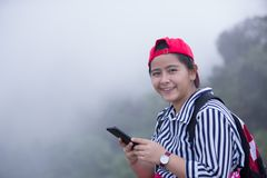 Young asian girl enjoy her smart phone Royalty Free Stock Image