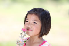 Young Asian girl with flowers Stock Photo