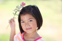 Young Asian girl with flowers Stock Image