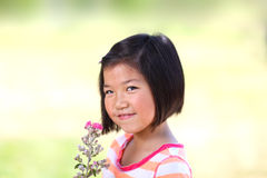Young Asian girl with flowers Royalty Free Stock Photo