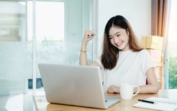 Young asian girl is freelancer with her private busines. S at home office, working with laptop, coffee, online marketing, Customer order and packaging or packing Stock Photo