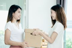 Young asian girl is freelancer with her private business. At home office, working with laptop, coffee, online marketing, Customer order and packaging or packing Stock Photos