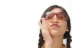 Young asian girl giving an air kiss stock photos