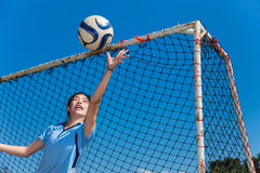 Young asian girl goalkeeper catching the ball Royalty Free Stock Image