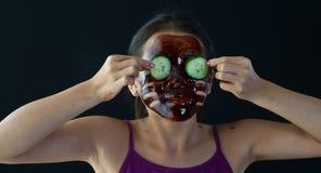 Young asian girl having fun with a chocolate mask stock photos