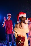 Young Asian girl hiding a her gift box and will give it to her boyfriend. With love in Valentine day and they are celebrate the Christmas party together Stock Images