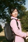Young asian girl holding books Stock Photos