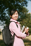 Young asian girl holding books Stock Photo
