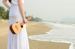 Free Young Asian Girl Holding Ukulele On The Beach Royalty Free Stock Images - 46540609