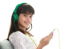 Young Asian girl listening to music with headphone and smarthpho Stock Photos