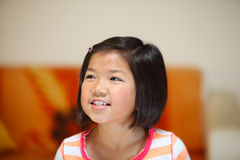 Young asian girl looks off camera Stock Photos