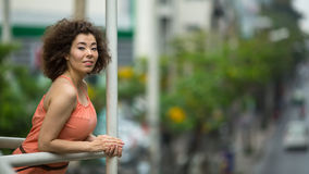 Young  Asian girl looks to the overpass on the road. Stock Photo