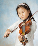 Young asian girl played violin Stock Image