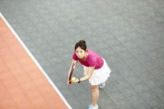Young asian girl playing tennis royalty free stock photography