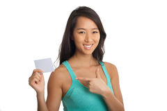 Young Asian girl pointing blank paper Royalty Free Stock Photography