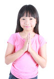 Young asian girl put her hands together and pray. Over white background Stock Photo