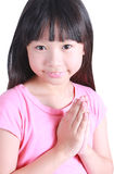 Young asian girl put her hands together and pray Stock Images