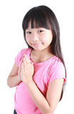 Young asian girl put her hands together and pray. On the white background Royalty Free Stock Images