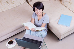 Young asian girl reading book Stock Photo