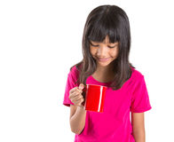 Young Asian Girl With Red Mug II Stock Photography
